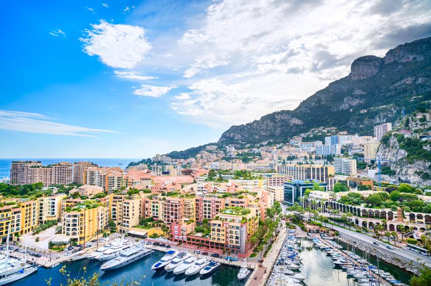 Monaco Montecarlo principality aerial view cityscape. Skyscrapers, mountains and marina. Azure coast. France, Europe.