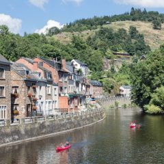 La Roche-En-Ardennes, Belgium - August 13, 2016: People with Kayaks on August 14, 2016 at river Ourthe in the historic centre of La Roche-en-Ardenne, Belgium